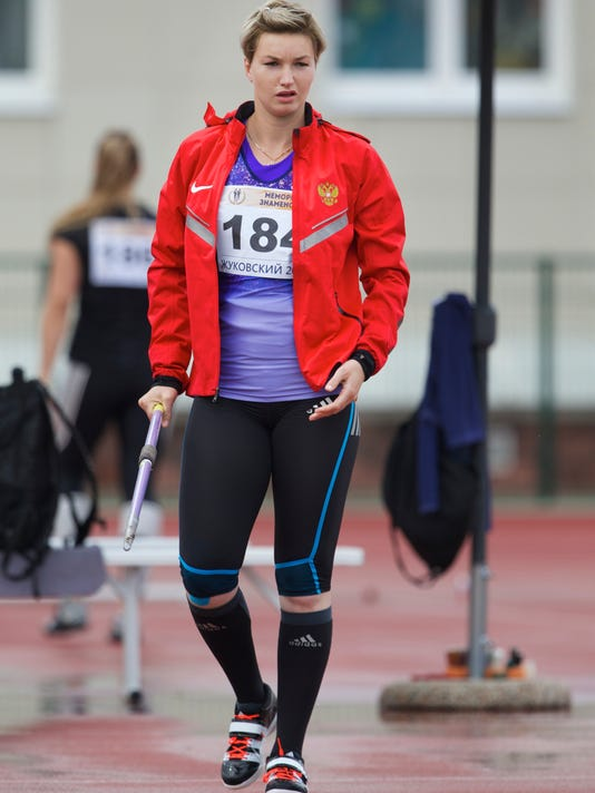 In this photo taken Saturday, June 4, 2016, Russia's javelin thrower Vera Rebrik competes at the Znamensky Brothers Memorial athletics meet in Zhukovsky just outside Moscow, Russia. Former European champion javelin thrower Vera Rebrik is trying to rebuild a career thrown into turmoil by her decision in 2014 to switch from Ukraine to Russia. Two years on from Russia's annexation of Crimea, athletes from the Black Sea peninsula are split between Russia and Ukraine and could win medals for both countries at August's Olympics in Rio. (AP Photo/Ivan Sekretarev)