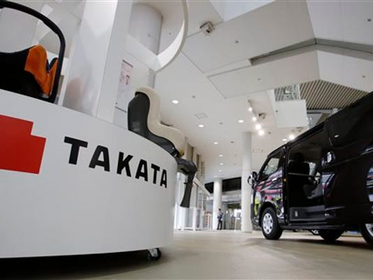 FILE - In this Nov. 6, 2014 file photo, child seats manufactured by Takata Corp. are displayed at a Toyota Motor Corp.'s showroom in Tokyo. Toyota and Nissan Motor Co. are expanding their recalls over problem air bags made by Japanese supplier Takata Corp. Toyota said Wednesday, May 13, 2015, it was recalling nearly 5 million more vehicles globally for the air bag inflator problem. Some 637,000 of them in the United States. In Japan, it is recalling nearly 1.4 million vehicles.