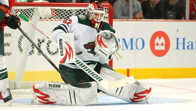 Minnesota Wild goalie Niklas Backstrom makes a save during the second period against the Blackhawks at the United Center.