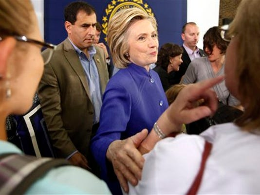 Democratic presidential candidate Hillary Rodham Clinton meets with voters during a campaign stop at River Valley Community College Tuesday, Aug. 11, 2015, in Claremont, N.H.