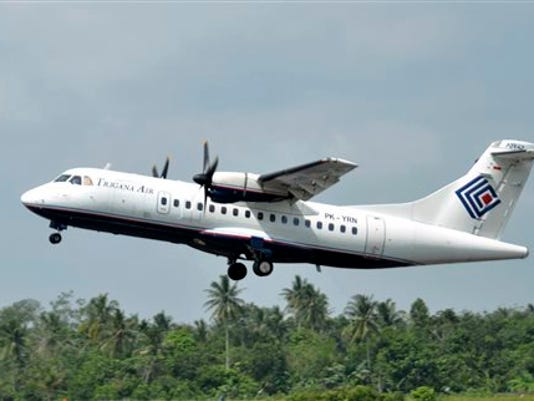 In this photo taken Dec. 26, 2010, Trigana Air Service's ATR42-300 twin turboprop plane takes off at Supadio airport in Pontianak, West Kalimantan, Indonesia. The same type of a Trigana airliner carrying 54 people was missing Sunday, Aug. 16, 2015 after losing contact with ground control during a short flight in bad weather in the country's mountainous easternmost province of Papua, officials said. A search for the plane was suspended and will resume Monday morning.