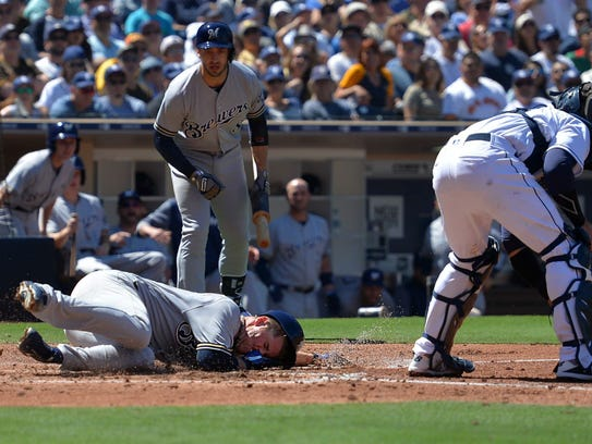 Brewers starting pitcher Chase Anderson scores on an