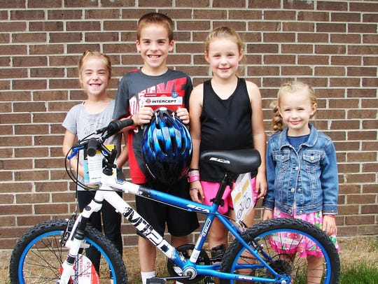 Carter Anderson of Marlette won a bike during the DARE