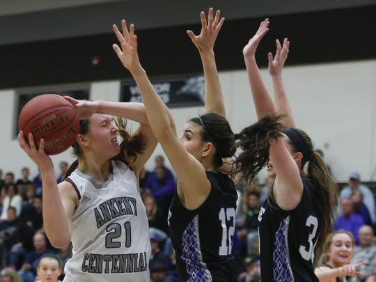 Ankeny Centennial freshman Rachel Schon fights her way to the basket as Waukee senior Reilly Jacobson stands in her way. The Jaguars twice beat top-ranked Waukee.