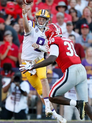 LSI quarterback Joe Burrow (9) throws over a Georgia defender during an NCAA college football game Saturday, Oct. 13, 2018, in Baton Rouge, La. (Bob Andres/Atlanta Journal Constitution via AP)