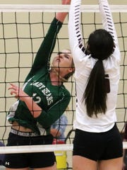 Cloudcroft's Kylee Coupland tries to get a ball over the outstretched hands of Tularosa's Tayler Noblitt.