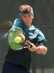 Jacob Bullard of So. Cal. returns volley during the final day of play of the USTA Intersectional Tennis 16s at Pierremont Oaks Tennis Club.
