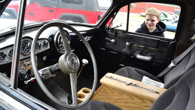 Isiah Teeter from Athens, Pa., peers into a vintage car at last year's Blast From the Past.