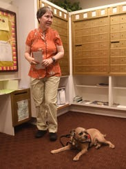 Sandy Keavey, of Dearborn, and her service dog Snickers