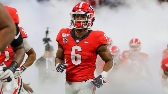 Georgia running back Kenny McIntosh (6) takes the field before the start of the Southeastern Conference championship NCAA college football game game between Georgia and LSU on Saturday, Dec. 7, 2019, in Atlanta.
