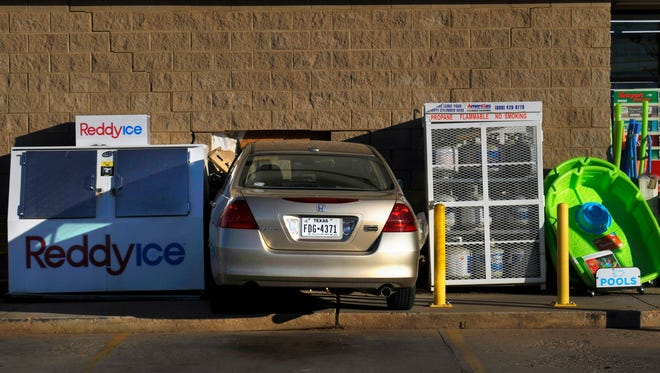 A car sits wedged into the Dollar General Store at 6617 Buffalo Gap Road Wednesday evening, June 21, 2017. Officials at the scene believed the driver mistakenly hit the gas pedal instead of the brake, causing the accident. No one was injured.