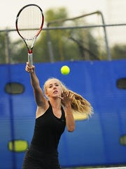 Team captain Kaydee Miller plays doubles at the Tigers' doubles tournament on Saturday at South Junior High.