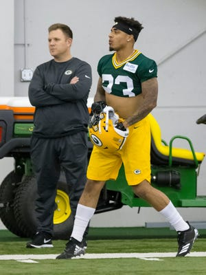 Packers general manager Brian Gutekunst (left) made his top pick with cornerback Jaire Alexander (right), but will he continue to upgrade the roster with free agents?