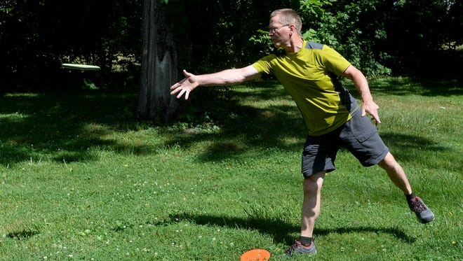 Bill Rohe practices disc golf Tuesday, June 28, 2016, at Glen Miller Park in Richmond.