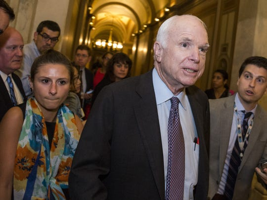 Sen. John McCain is pictured leaving the Senate Chamber after the Senate narrowly defeated a bill early Friday that would have repealed limited portions of the Affordable Care Act.