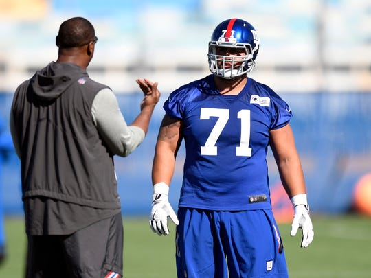 New York Giants guard Will Hernandez #71 talks to a coach during rookie minicamp in East Rutherford, NJ on Friday, May 11, 2018.