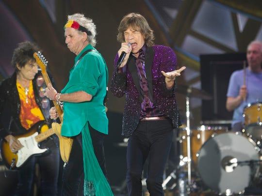 Rolling Stones singer Mick Jagger performs with Keith Richards, second left, Ronnie Wood, left, and drummer Charlie Watts during a concert in Hayrkon Park in Tel Aviv, Israel.
