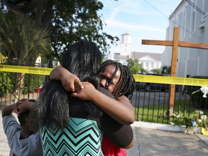 Kearston Farr comforts her daughter, Taliyah Farr,