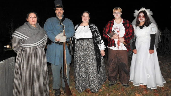 Tour guides and their ghostly assistants at the Old Centre Burial Ground in Winchendon: Caitlin Staples, left, Tom Bossolait, Amy Scott, Erin Scott and Alyssa Scott.