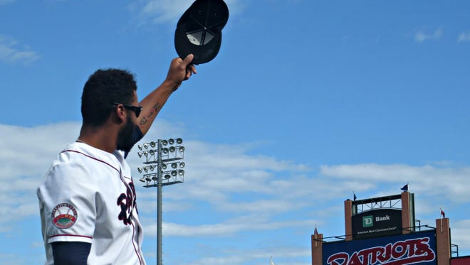 The Somerset Patriots' Matt Fields tips his hat to the stands Sunday as the team announces his retirement.