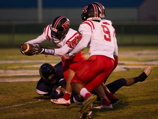 Fred Orr (2) goes in to try to make a touchdown for