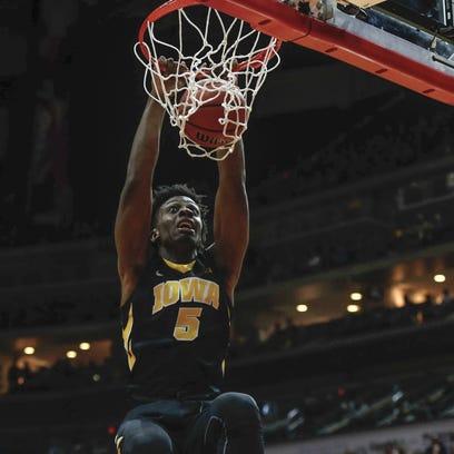 Iowa sophomore Tyler Cook dunks the ball against Drake