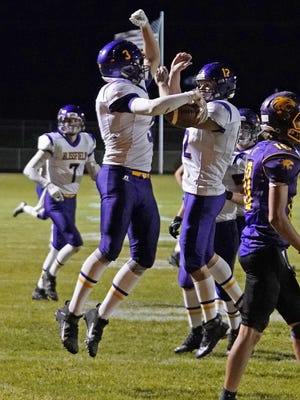 Blissfield receiver Zack Horky (3) and quarterback Gavin Ganun (12) celebrate after scoring a touchdown in the first half of Friday's 49-14 victory over Onsted.