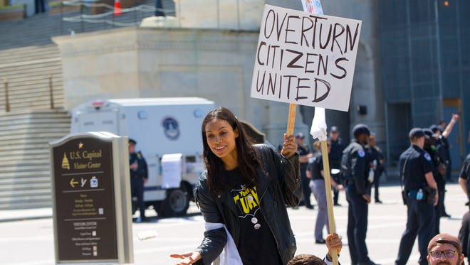 Actress Rosario Dawson was part of the Democracy Spring rally demanding campaign finance reform.