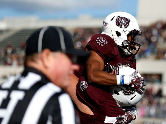 Missouri State's Myron Mason is picked up by Aaron Clardy after Mason scored a touchdown against the Indiana State Sycamores during the Bears homecoming football game at Plaster Stadium in Saturday, Oct. 28, 2017.