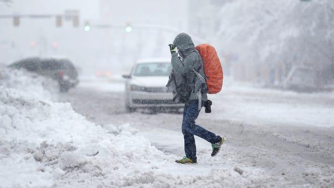 A person walks in downtown Salt Lake City Monday, Dec. 14, 2015.