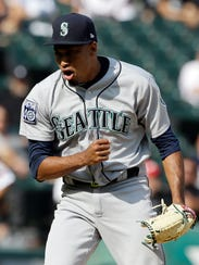 Seattle Mariners closer Edwin Diaz reacts after his