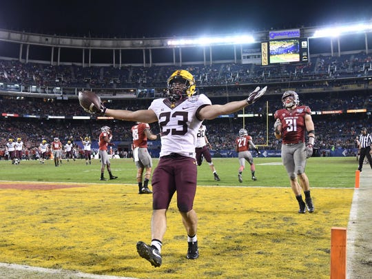 Minnesota receiver Shannon Brooks celebrates after catching a 13-yard touchdown pass in the third quarter against Washington State.