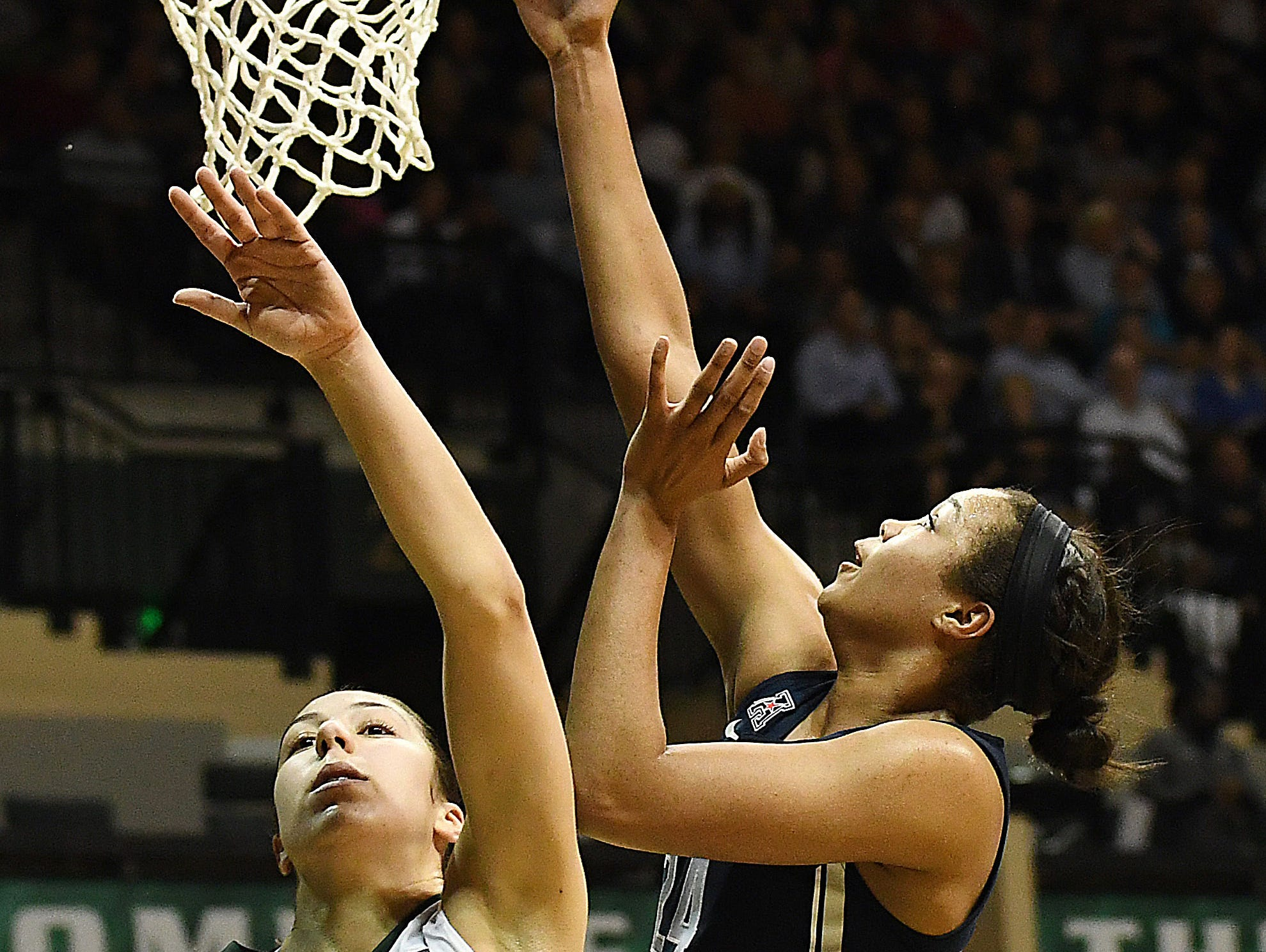 Connecticut forward Napheesa Collier takes a shot over South Florida guard Laia Flores during the first half at USF Sun Dome in Tampa.