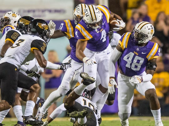 Tigers running back Nick Brossette (4) leaps over the defender to get the first down during the first half of a non SEC game between the Southern Miss Golden Eagles and the LSU Tigers in Baton Rouge on Saturday October 15, 2016 BUDDY DELAHOUSSAYE/ THE ADVERTISER