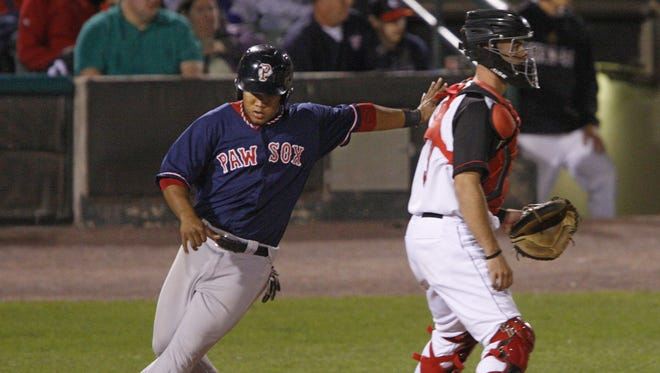 Pawtucket's Heiker Meneses races home past Rochester catcher Eric Fryer to score on a single by Brock Holt in the fourth inning of Pawtucket's 7-2 win over Rochester on Thursday, Sept. 5, 2013 at Frontier Field.