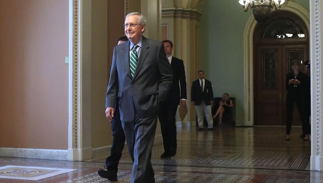 Senate Majority Leader Mitch McConnell (R-KY) walks to his office on Capitol Hill on June 22, 2017 before Senate Republicans released their version of the House-passed health care bill.