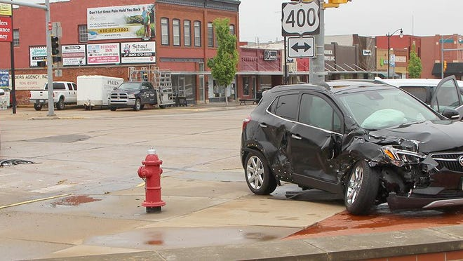 A 2017 Buick Encore sits between a fire hydrant and a traffic signal pole at the intersection of First and Main in Pratt after it turned in front of a 2015 GMC Sierra 2500 pickup and was broadsided Wednesday afternoon.