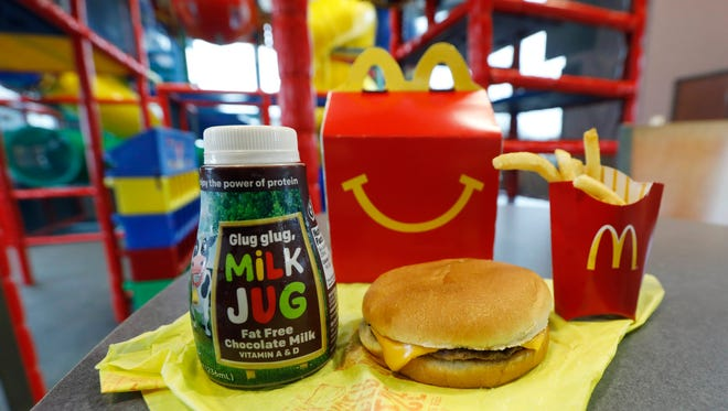 A Happy Meal featuring non-fat chocolate milk and a cheeseburger with fries, are arranged for a photo at a McDonald's restaurant in Brandon, Mississippi.