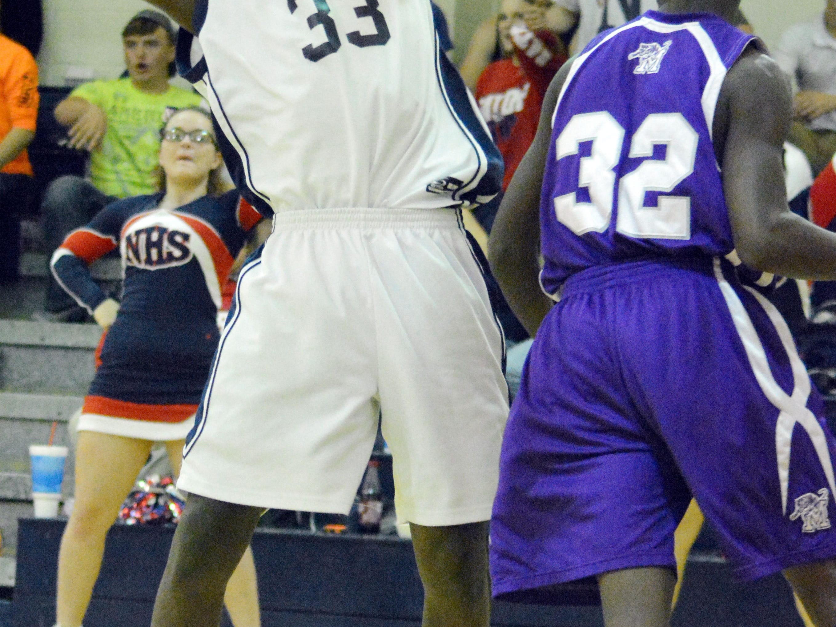Northwood's Danny Slaughter (33, left) blooks to pass over Montgomery's Troy Turner (32, right) Friday.