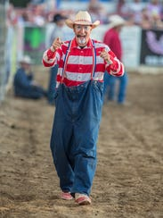 Rodeo clown CrAsh Cooper plays to the crowd on Thursday