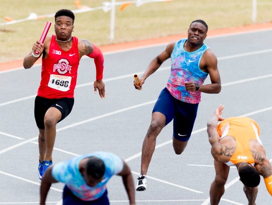 Christian Coleman sprints towards  Justin Gatlin during