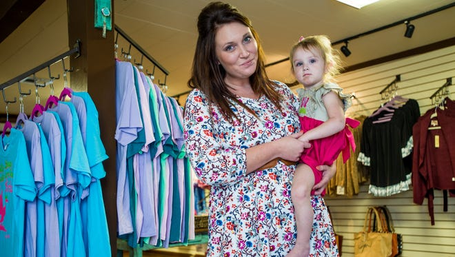 Mandi Plesscher (pictured with her daughter) owns  Cajun Belle in Lafayette.