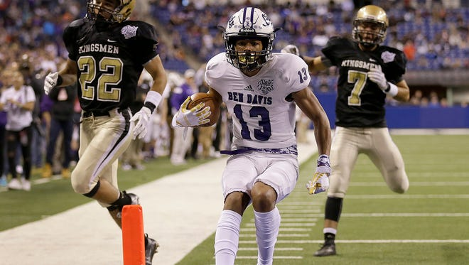 Ben Davis Giants Broc Thompson (13) scores a touchdown against the Penn Kingsmen in the first half of their IHSAA 6A State Football finals game at Lucas Oil Stadium Saturday, Nov. 25, 2017.