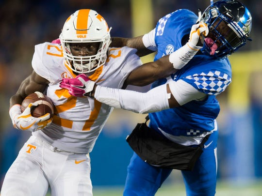 Tennessee running back Carlin Fils-aime (27) runs the