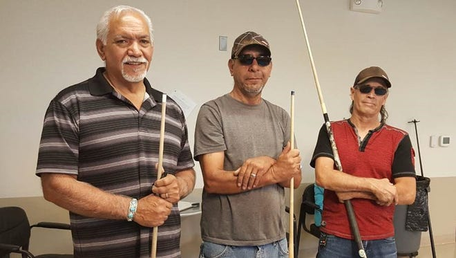 Pictured left to right are the June 8-ball billiards tournament winners: Henry Telles of Las Cruces (first place), Carlos Hernandez of Las Cruces (second place), Ray Acosta of Las Cruces (third place).