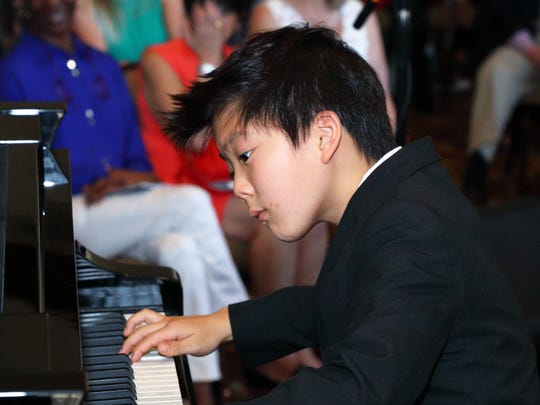 Competition winner 10-year old Jadon Wu performs.