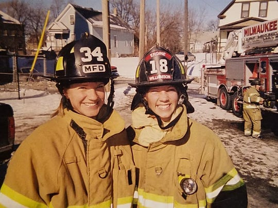 Kristin Ciganek-Schroeder (left) is pictured at a fire scene with her sister, Sandy Williamson, also a Milwaukee firefighter.