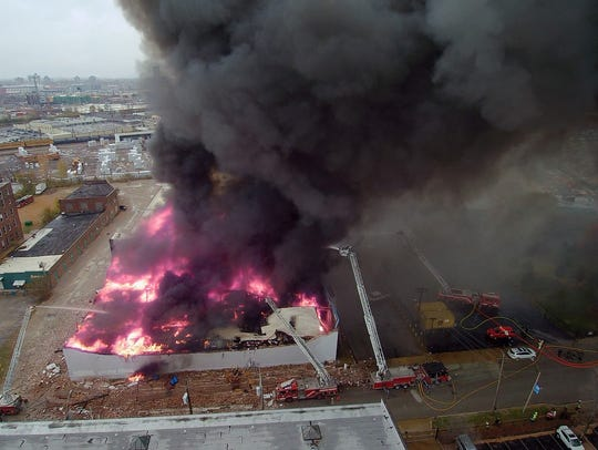St. Louis firefighters battle a five-alarm fire at