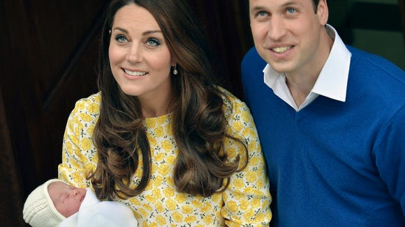 Britain's Prince William stands close to Kate, Duchess
