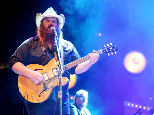 Chris Stapleton is performing during his concert at